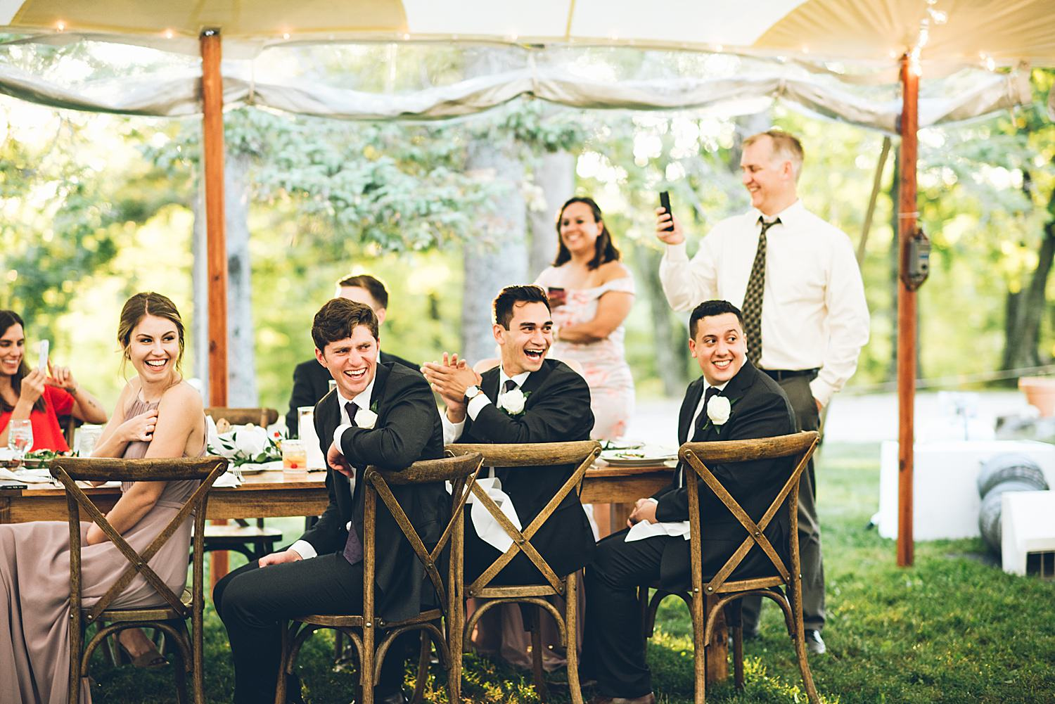 bridal party laughing at speeches
