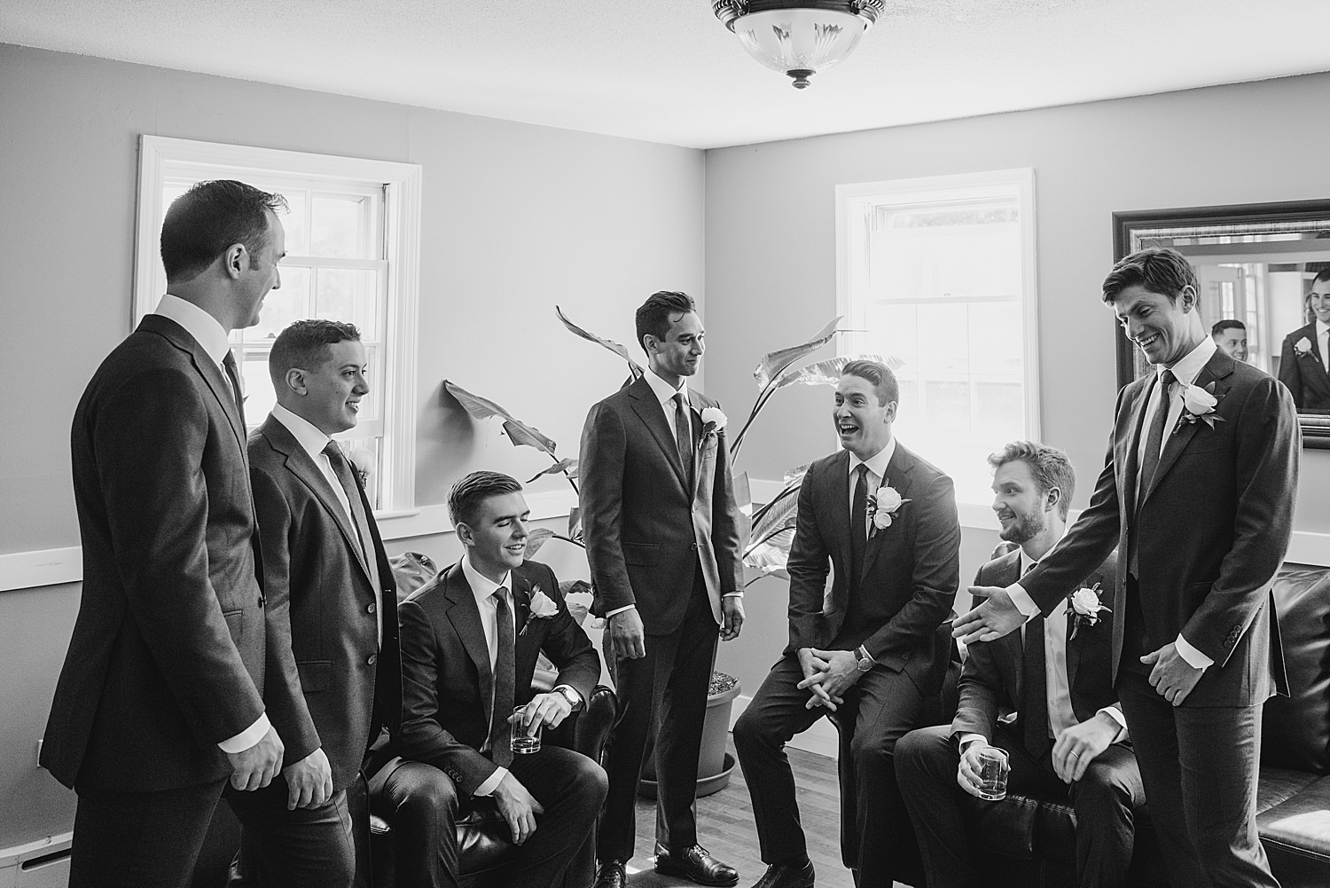 groom with his groomsmen getting ready