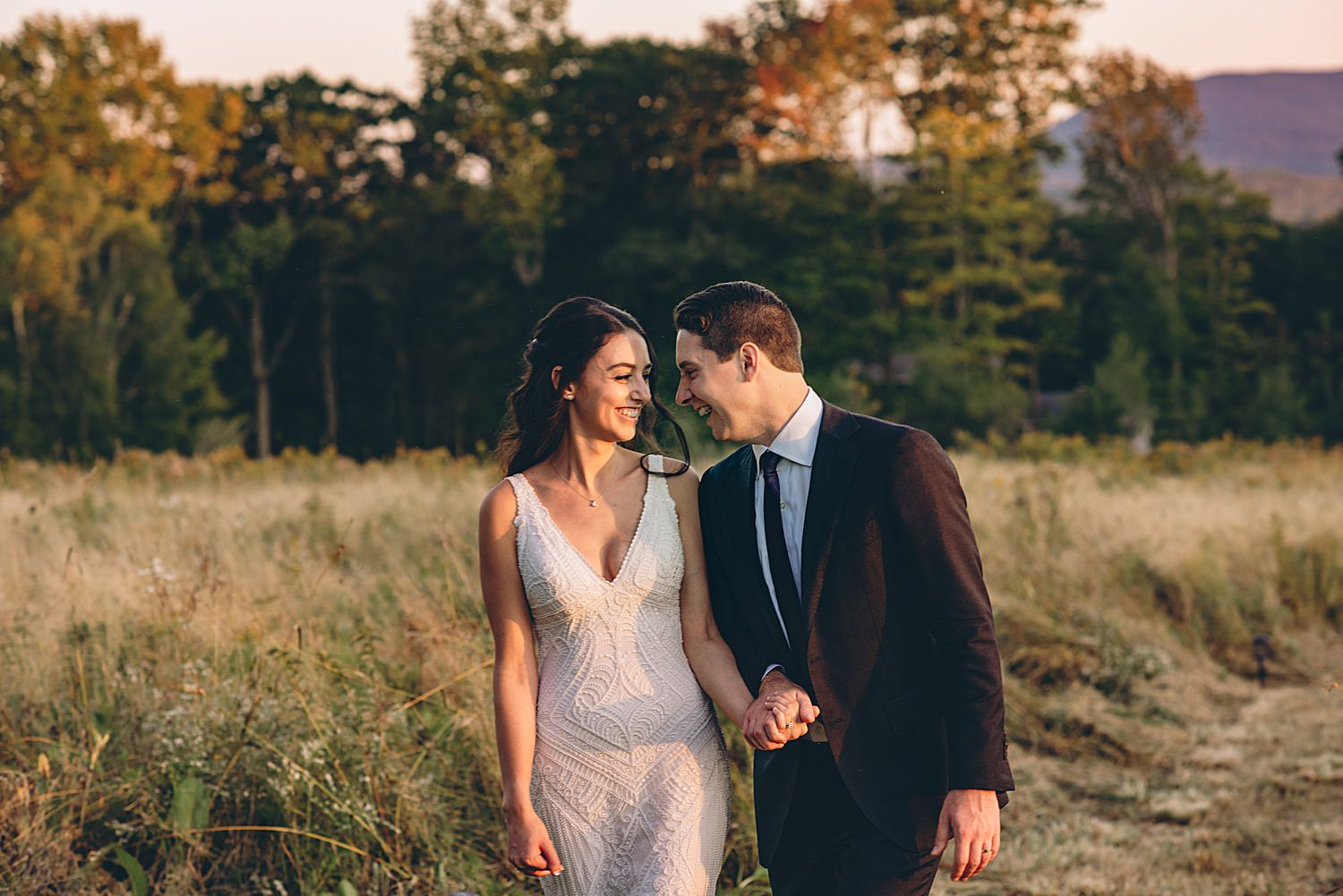 bride and groom laughing at golden hour