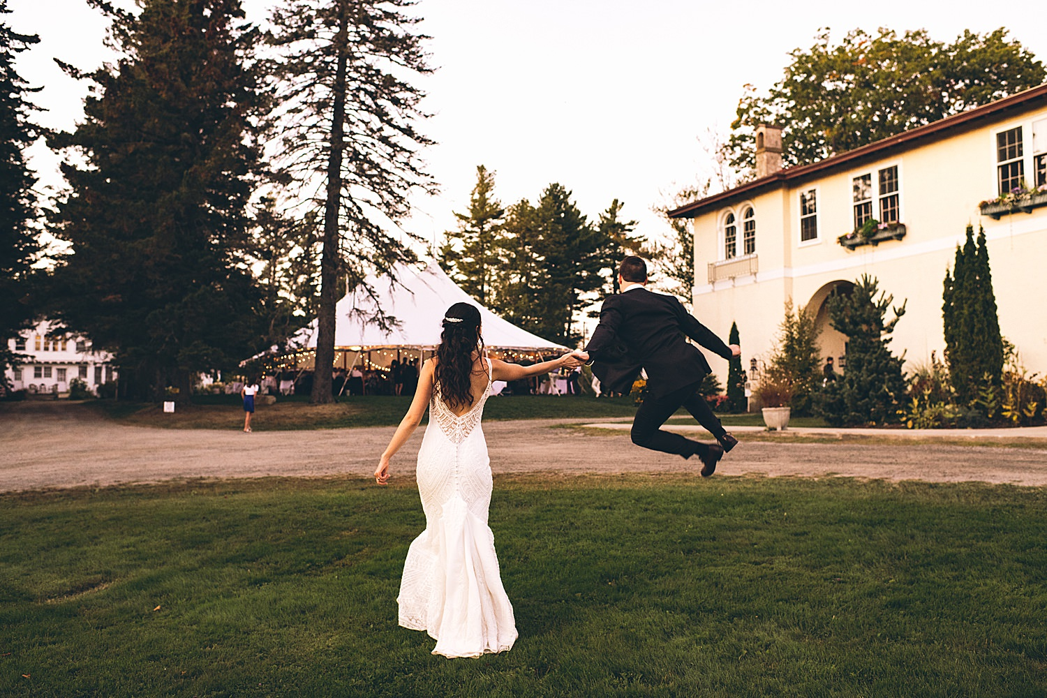 groom jumping and clicking heels
