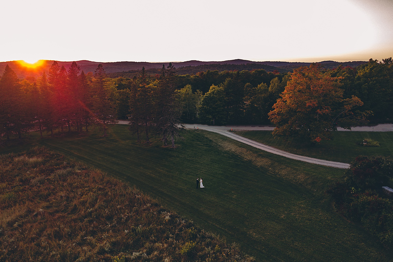 drone image of bride and groom at sunset